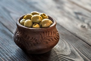 Bowl of olives on the wooden table