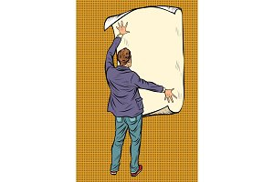 man unfolded poster paper