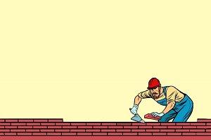 The Builder lays brick masonry below