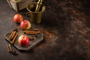 Fresh red apples with cinnamon stick