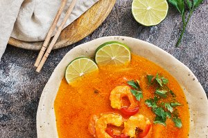 Soup with prawns on a rustic