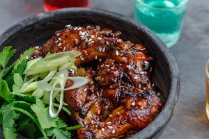 Spicy baked chicken wings in a bowl