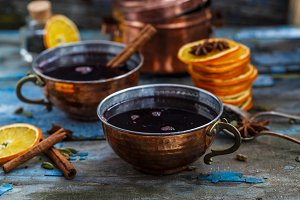 Mulled wine in copper cup close view