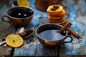 Grog in copper cups with spices and