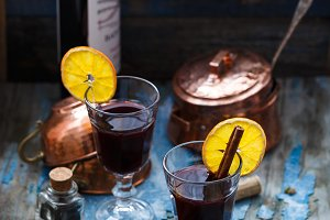 Mulled wine in glasses with ornge