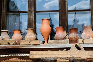 Crude clay jugs and carved pots