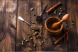 Making garam masala powder in mortar