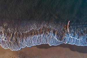 Aerial view of a runner on the beach