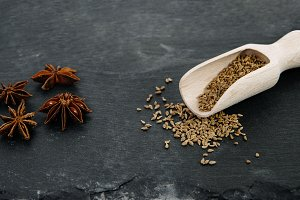 Anise whole and grains on dark