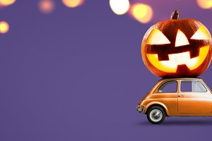 Halloween pumpkin on car