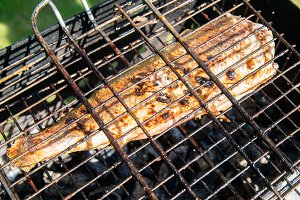Grilled fish on the barbecue grill