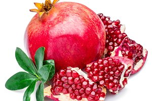 Ripe pomegranate fruits on the white