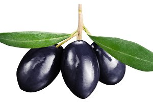 Black olives with leaves on a white