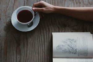 Hand grabbing a cup of tea
