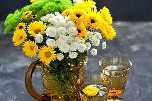 Bouquet of flowers in a glass jug an