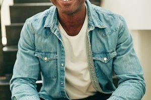 Smiling African businessman sitting