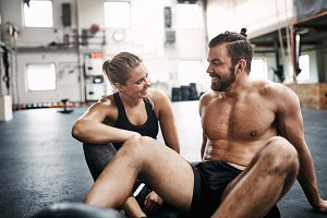 Fit couple smiling and talking durin