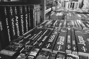 Black and white books on a shelf