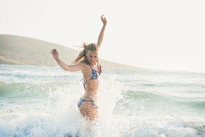 Young woman enjoying warm waters of