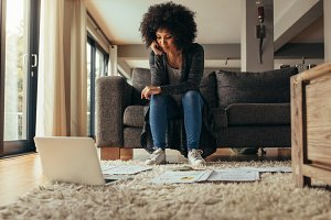 Woman at home studying business