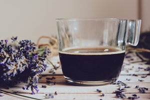 Cup of coffee and fresh lavender flo