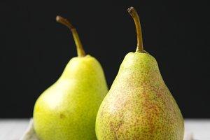 Tasty fresh pears on pink plate