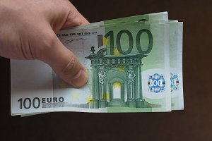 Hand with Euro notes, European Union