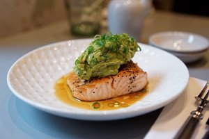 Fried salmon steak with guacamole