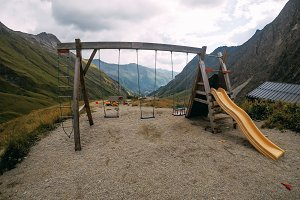 Children's playground with mountain