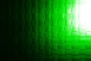 Green textured grid with light leak