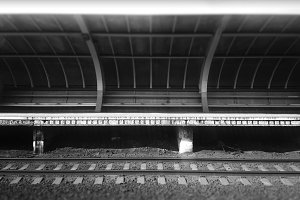Empty black and white railroad stati