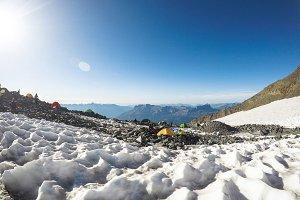 Tourist tents in valley between rock