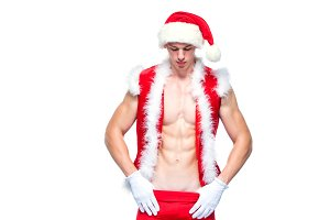 Sexy Santa Claus . Young muscular