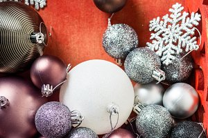 Christmas balls in red wooden box as
