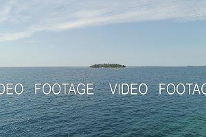 Tropical island Putipot with beach.