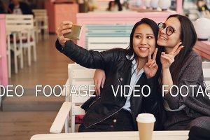 Pretty Asian girl is taking selfie
