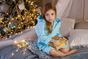 Little girl in bathrobe. Christmas