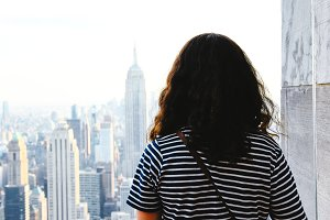 A Woman looking at New York skyline