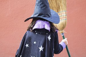 portrait of witch with broom on his