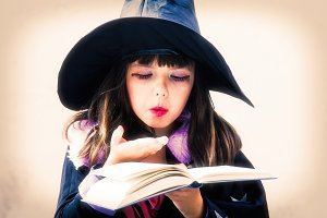 witch girl reading the spells in the