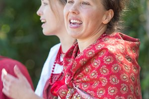 Smiling young women in russian folk