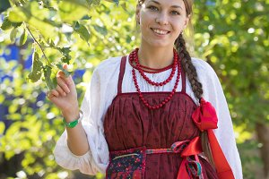 Smiling young woman in russian folk