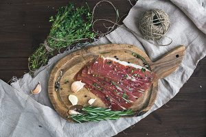 Prosciutto on a rustic wooden board