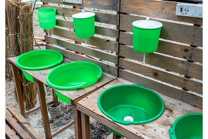Green washbasin in the yard. Hand