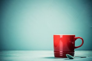 Red cup on blue background