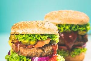 Homemade hamburgers on blue backgrou