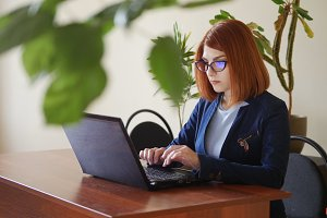 Young red hair officeworker women in