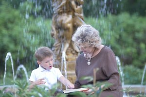 Grandmother with grandson reading a