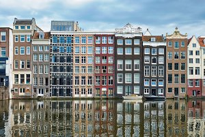 Amsterdam canal Damrak with houses