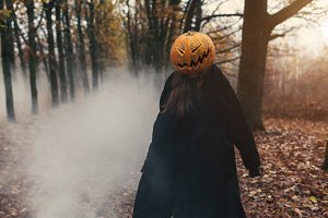 Young woman with a halloween pumpkin